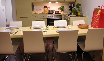 Dining table for 8 people complete with fully equipped kitchen in a SUN Matrei X-Large Design apartment