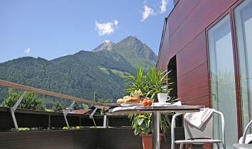 Terrace of the Design apartments with superb views to the mountains around Matrei in East Tyrol