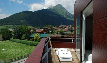 Terrace with massage couch available on loan and dreamy views to the Tyrol mountains